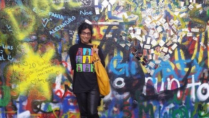 Senaratna in front of the famous John Lennon Wall in Prague.