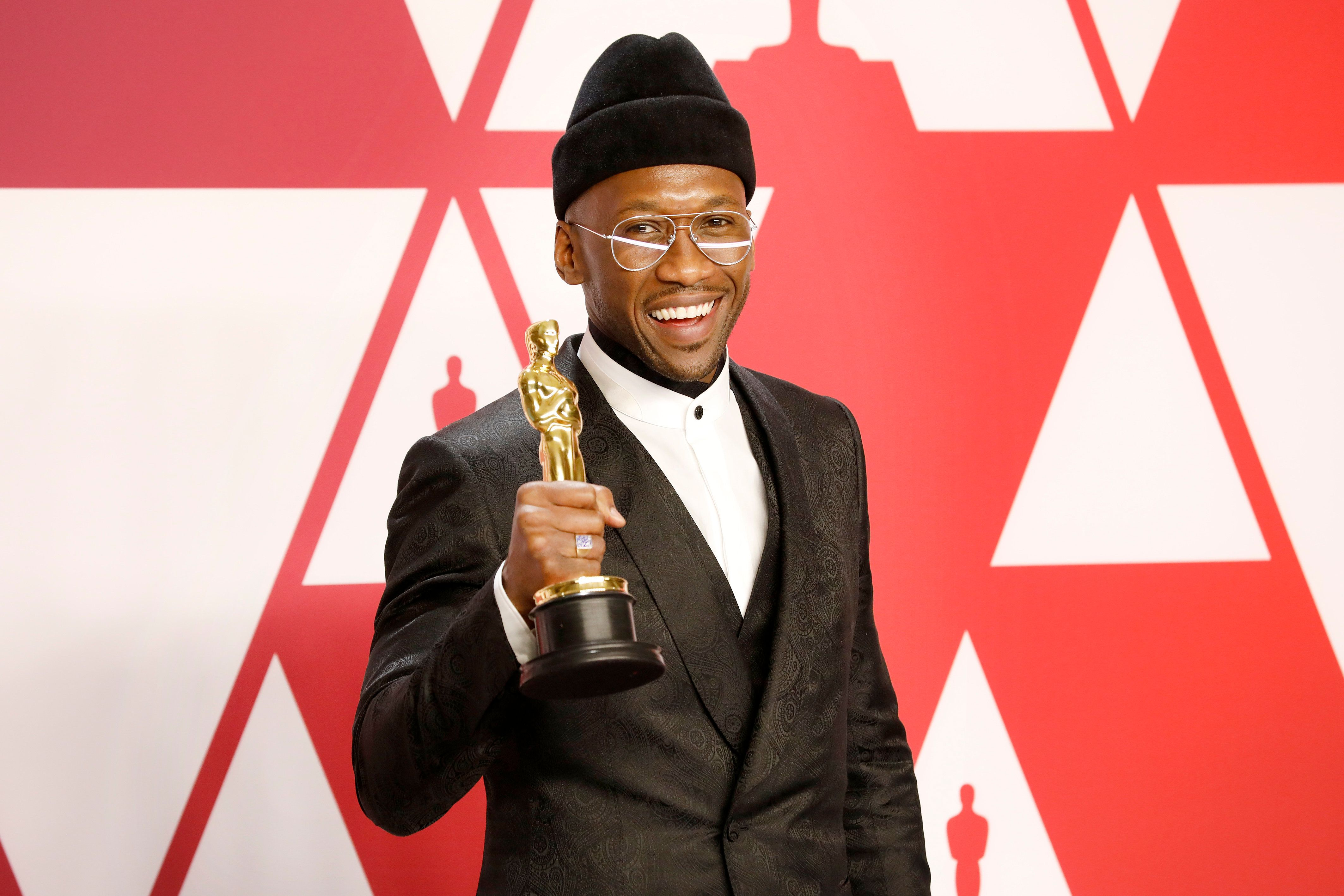 "Mahershala Ali with his award for Best Actor in a Supporting Role for ""Green Book"" at the 91st Annual Academy Awa"