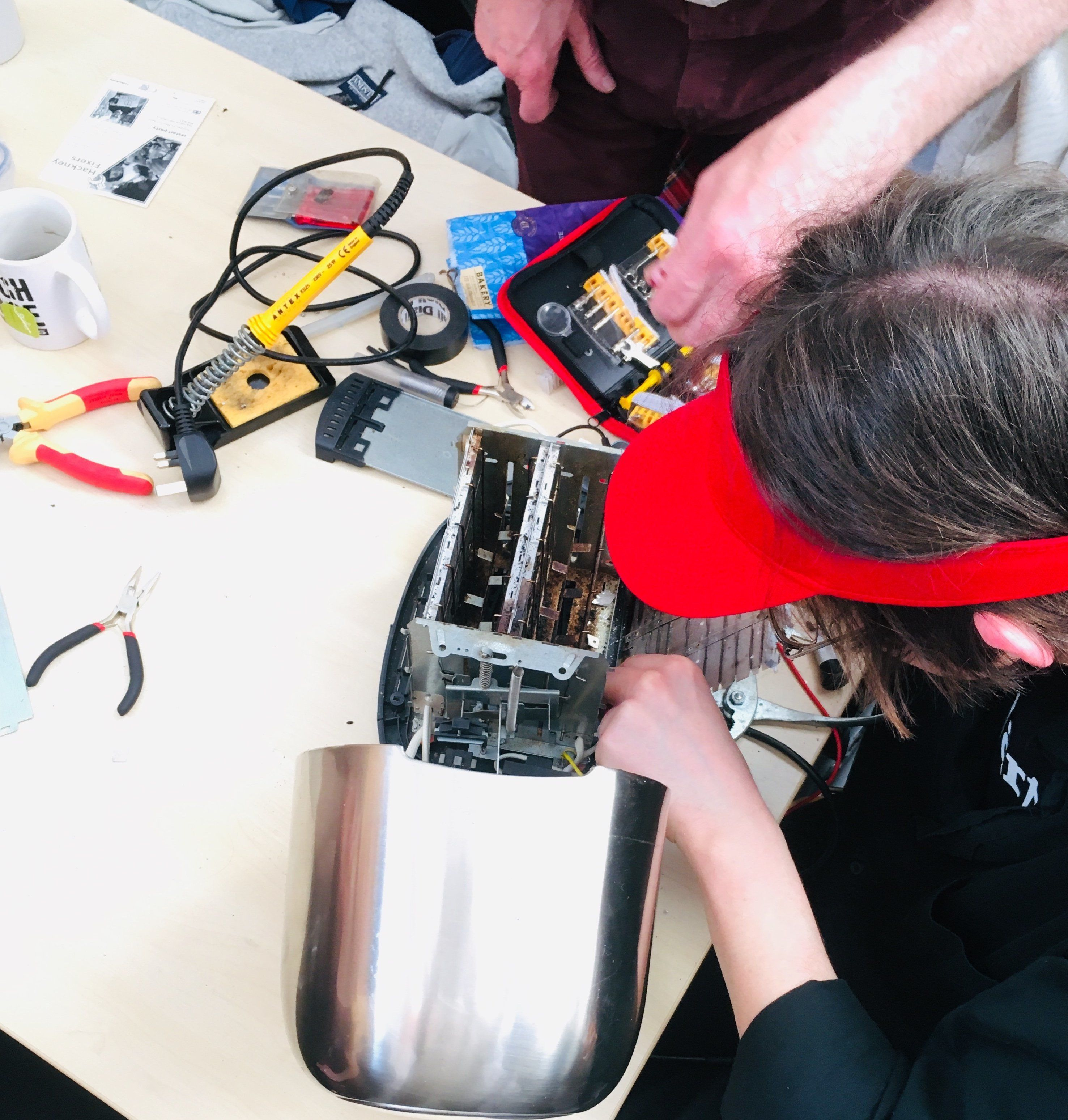 """A volunteer """"fixpert"""" assesses a broken toaster at the repair event I went to in London. The aim isn't just to fix the applia"""
