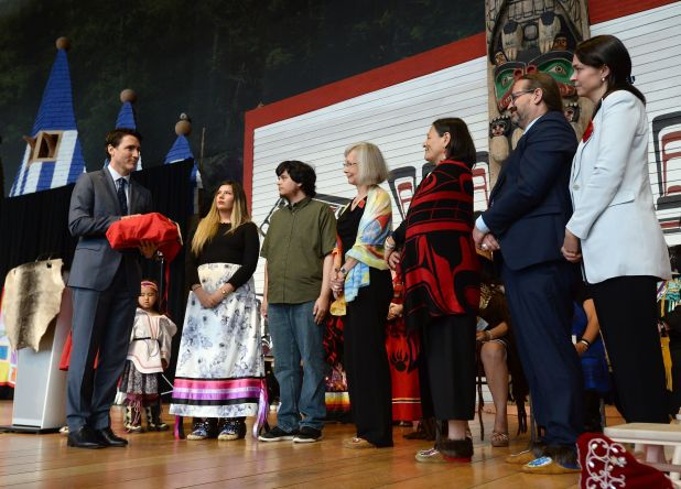 Prime Minister Justin Trudeau holds a copy of the National Inquiry into Missing and Murdered Indigenous...