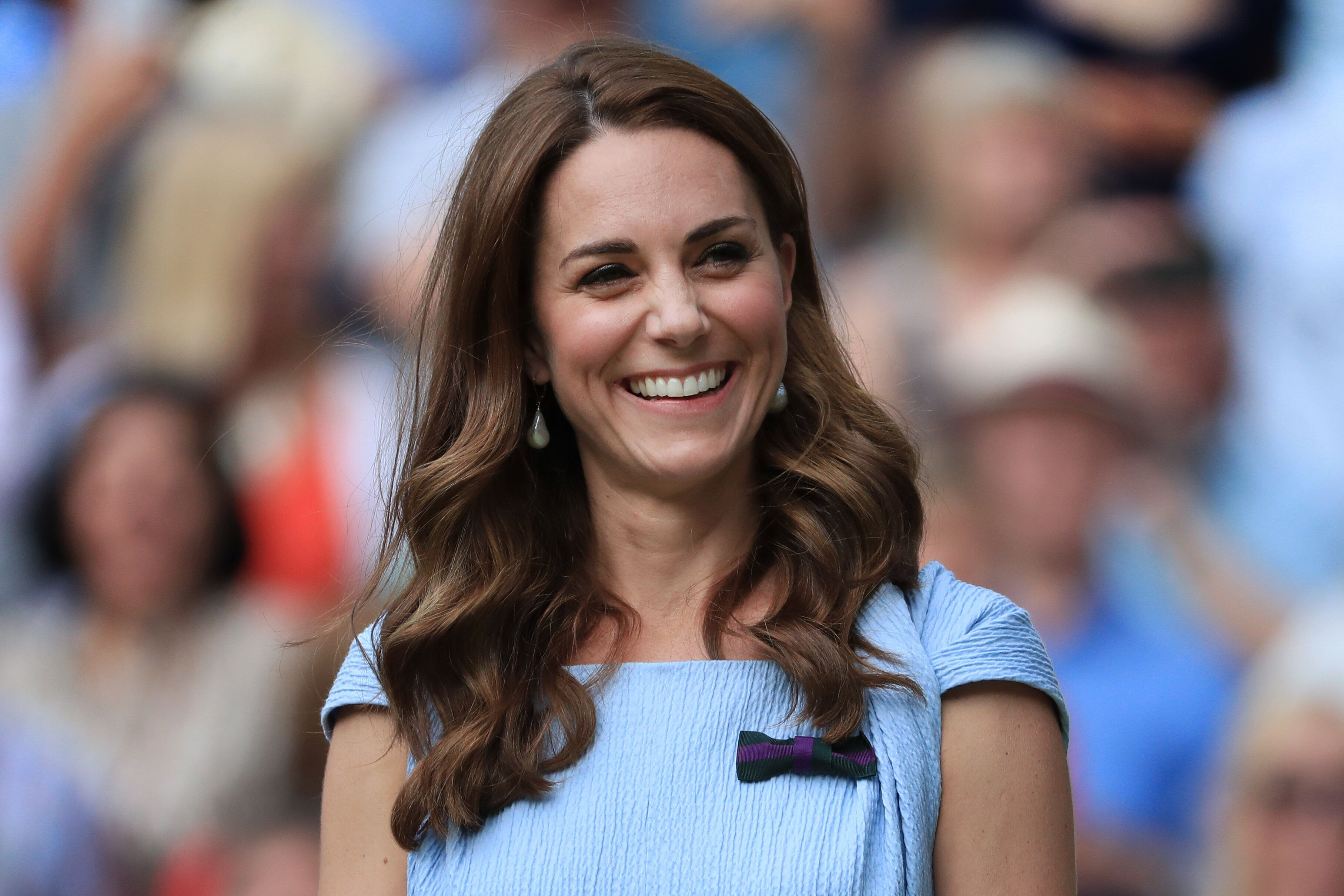 The Duchess of Cambridge laughs and smiles on Day 13 of The Championships - Wimbledon 2019 at the All England Lawn Tennis and