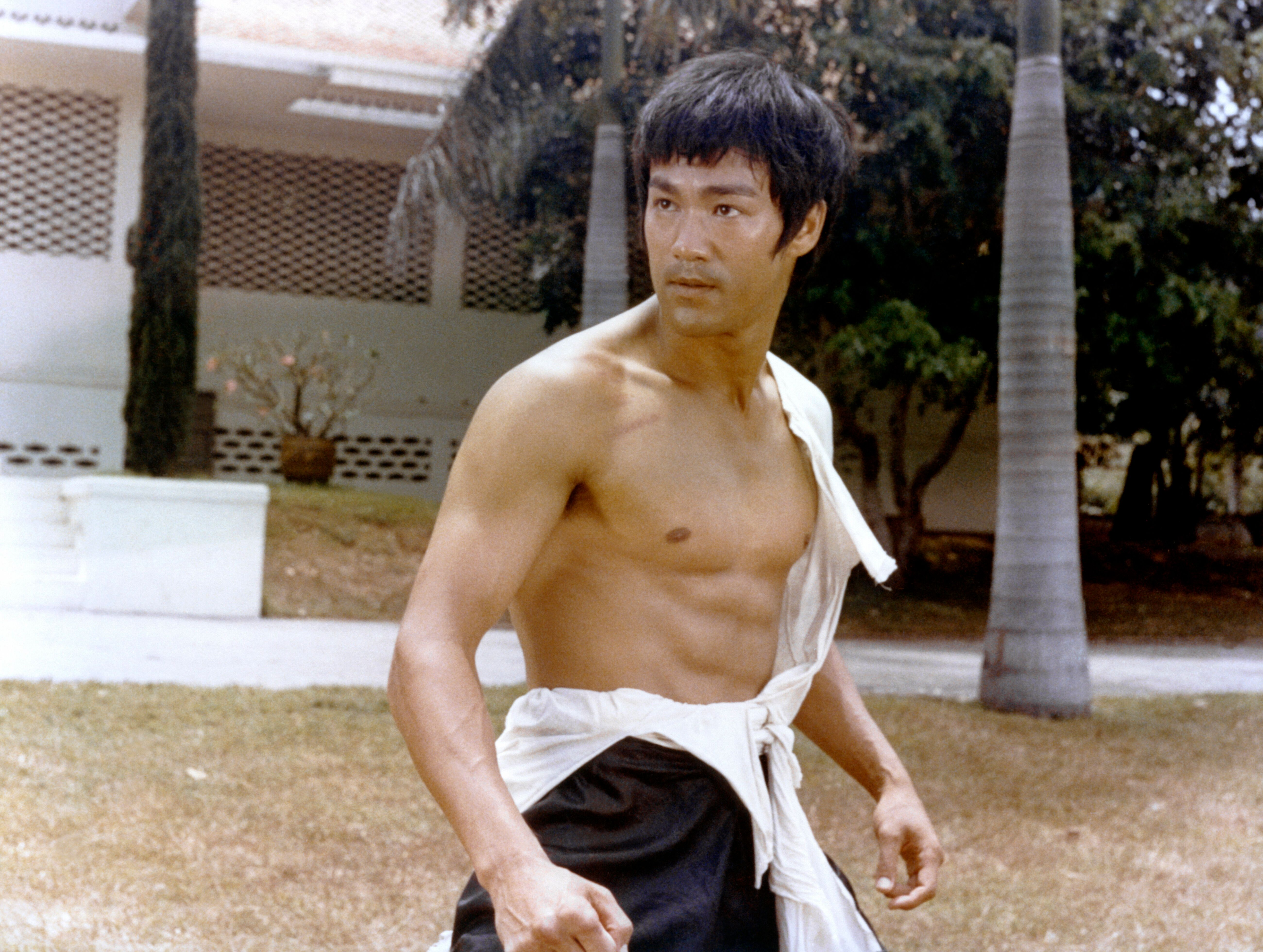 """A shirtless Lee on the set of """"Tang Shan Da Xiong"""" (""""Big Boss""""), written and directed by Wei Lo."""