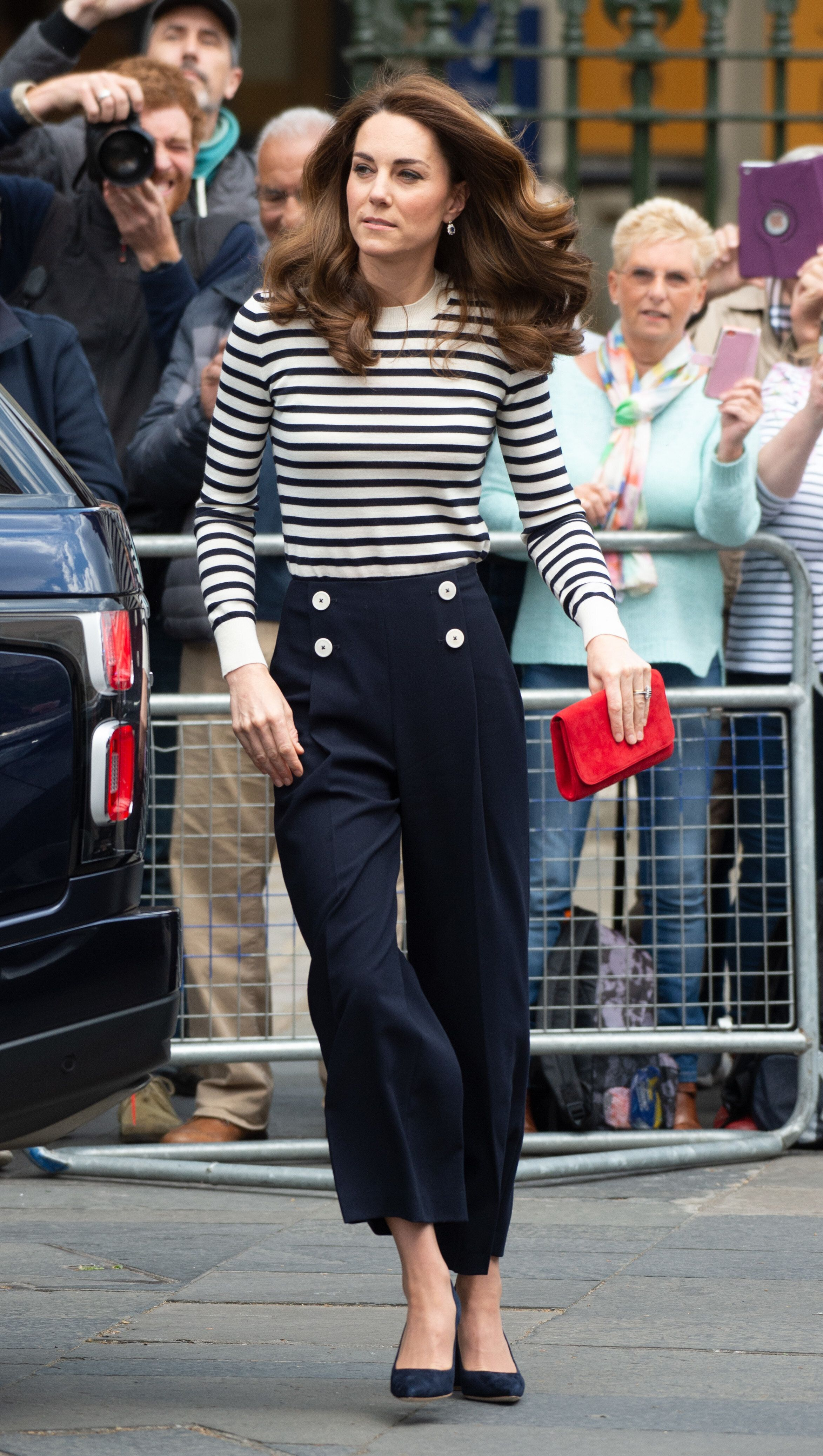 The Duchess of Cambridge wearing navy cropped L.K.Bennett trousers and a navy-and-white Breton top in London on May 7, 2019,