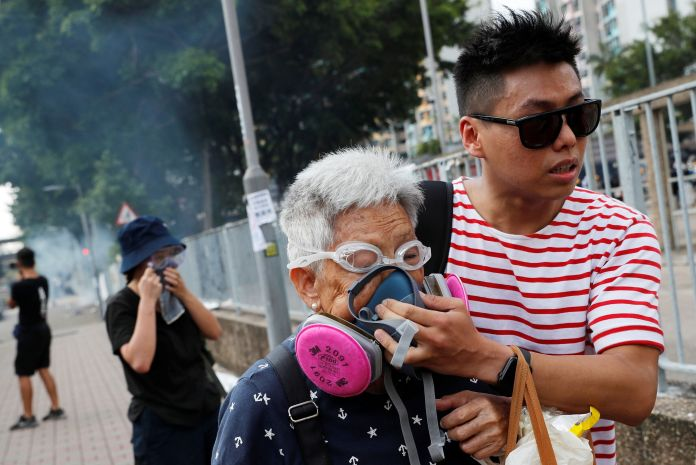 Tin Shui Wai, August 5, 2019. A protester helps a woman after the use of ...