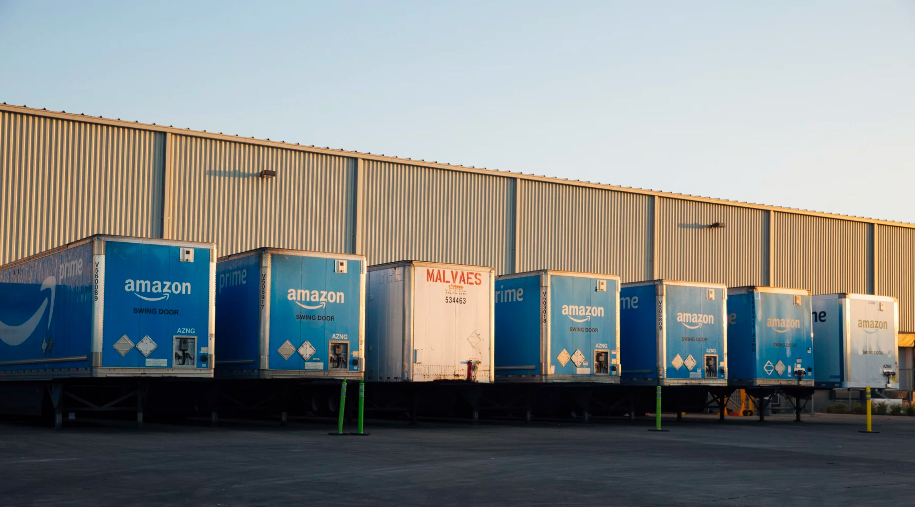 Tractor-trailers parked at an Amazon warehouse in Chicago, where they drop off goods to be picked up by fleets of cars, truck