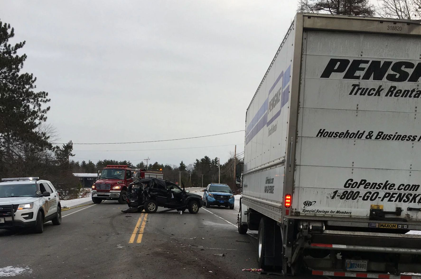 Ellen Kennedy's Jeep, center, and Romero's truck, right, in the aftermath of the crash that killed Gabrielle Kenn