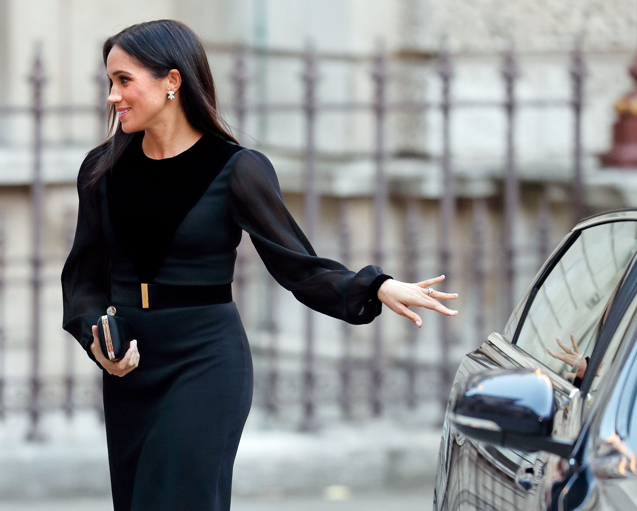 """The Duchess of Sussex arrives to open """"Oceania"""" at the Royal Academy of Arts on Sept. 25, 2018, in London."""