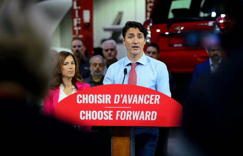 Liberal Leader Justin Trudeau makes a policy announcement and holds a media availability at an electric vehicle car dealership during a campaign stop in Trois-Rivieres, Quebec, on Friday, Sept. 13, 2019. (Sean Kilpatrick/The Canadian Press via AP)