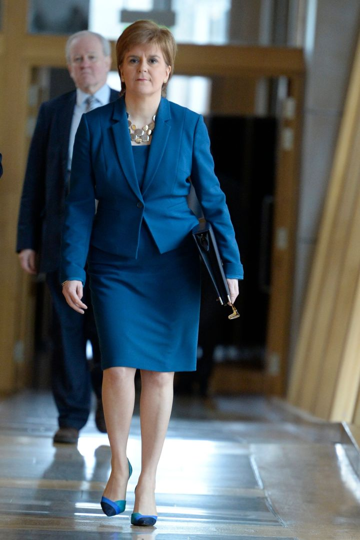 Scotland's First Minister, Nicola Sturgeon, on the way to take questions from Parliament members on March 22, 2018, in Edinburgh, Scotland.