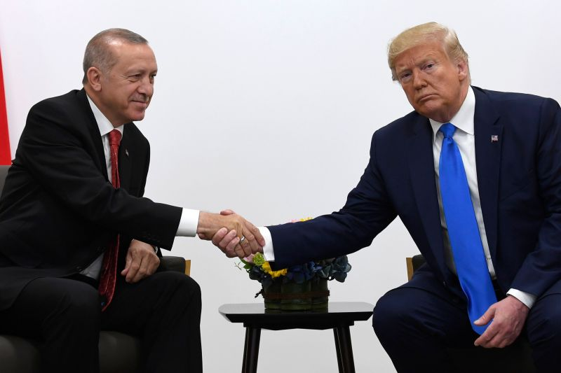 President Donald Trump, right, shakes hands with Turkish President Recep Tayyip Erdogan, left, during a meeting on the sidelines of the G-20 summit in Osaka, Japan, Saturday, June 29, 2019. (AP Photo/Susan Walsh)