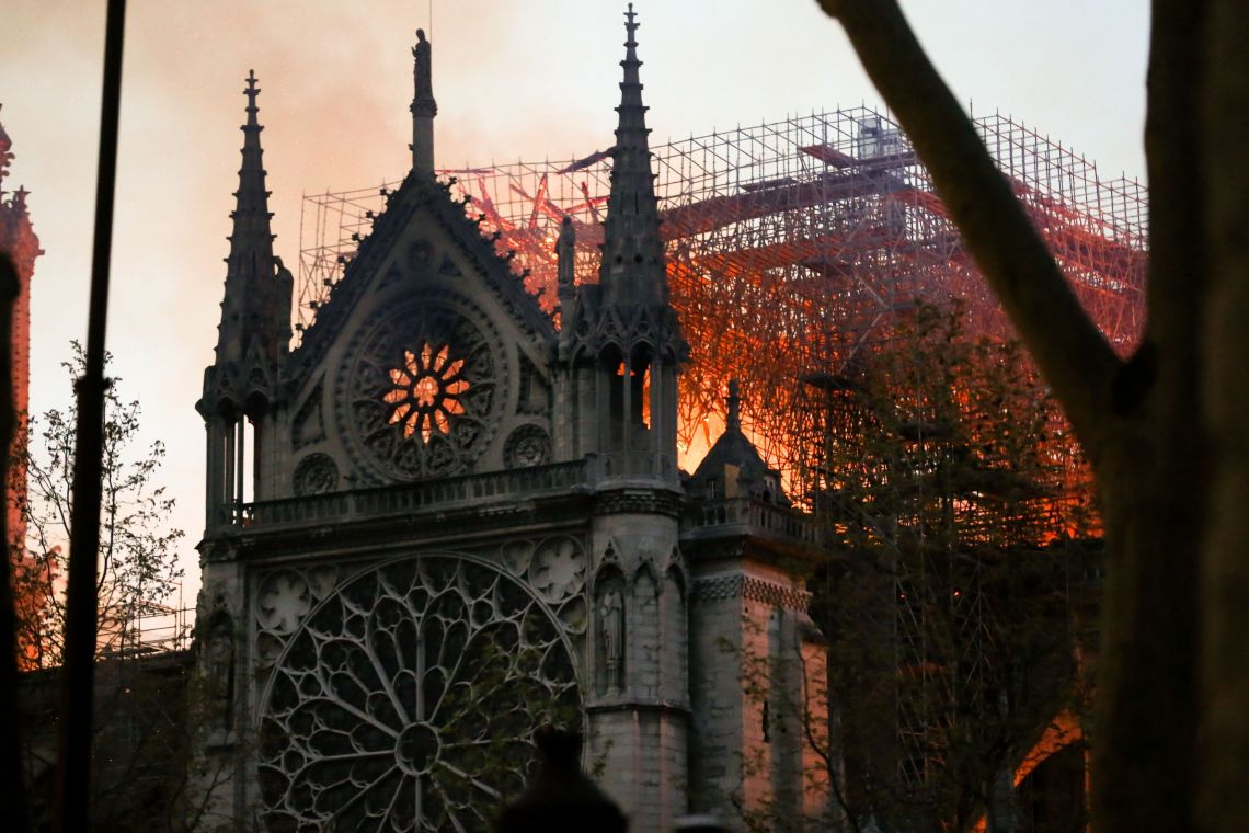 Flames and smoke billow from the roof at Notre-Dame Cathedral in Paris on April 15, 2019.