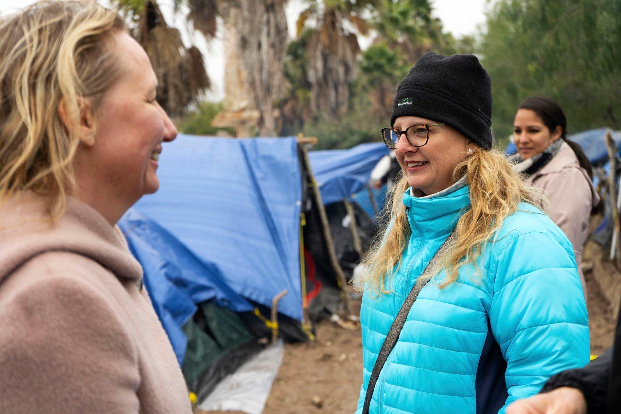Jodi Goodwin (center<strong>) </strong>at the refugee camp in Matamoros, Mexico.