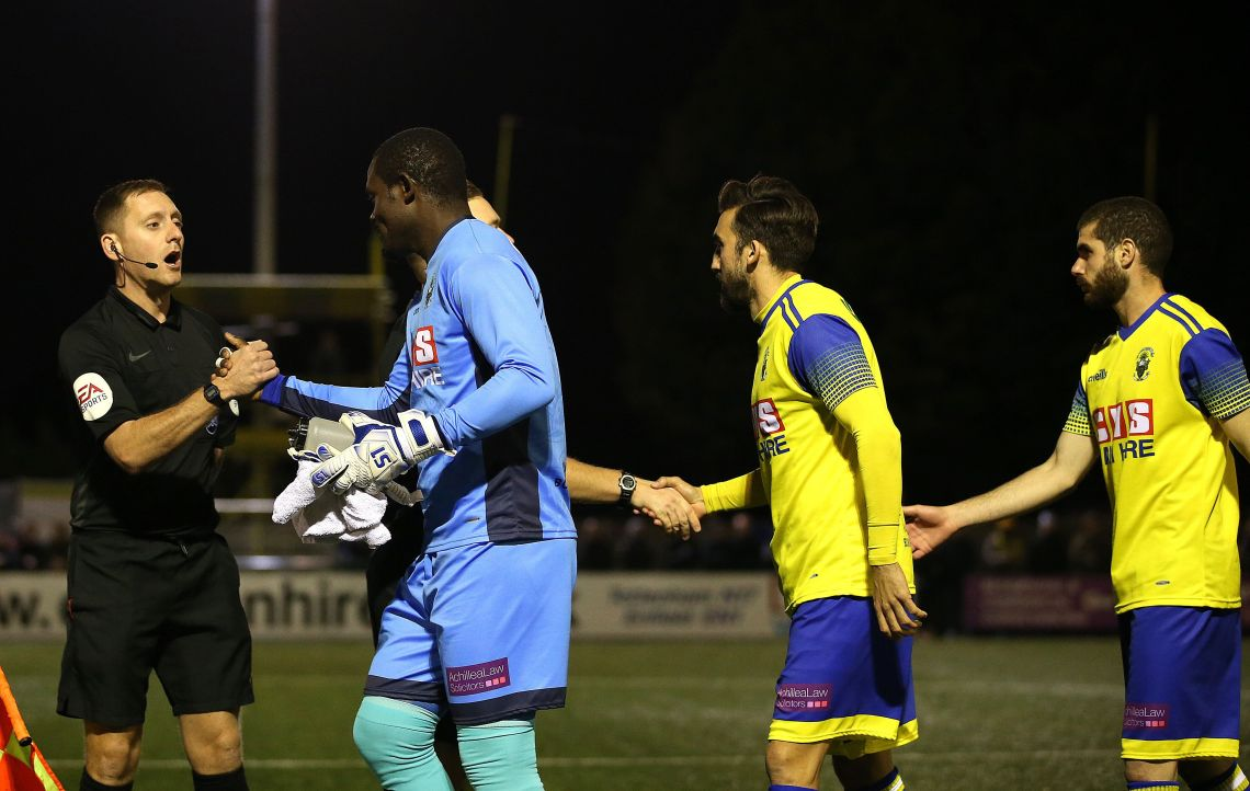 Haringey Borough goalkeeper Valery Pajetat (left) walks out onto the pitch at the start of the FA Cup fourth qualifying round replay match at Coles Park Stadium, London.