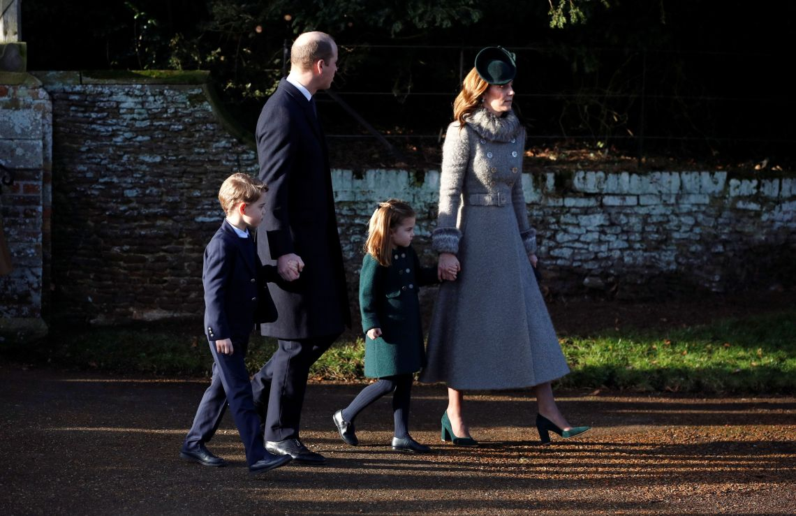 William Kate, Charlotte and George leave St. Mary Magdalene's church after the Royal Family's Christmas Day service.