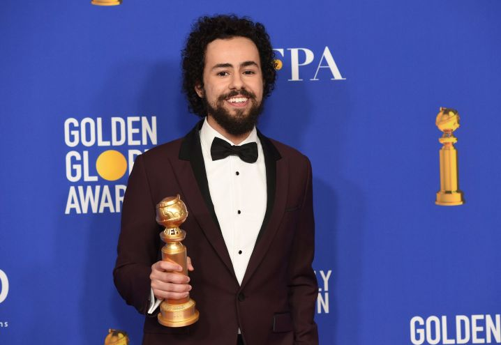 """Ramy Youssef with the award for best performance by an actor in a television series, musical or comedy, for """"Ramy"""" at the 77t"""