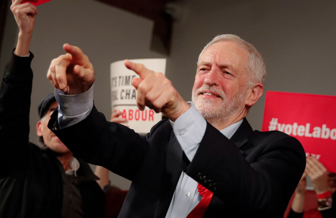 Labour Leader Jeremy Corbyn points his fingers at the end of an eve of poll rally in London, Wednesday, Dec. 11, 2019.