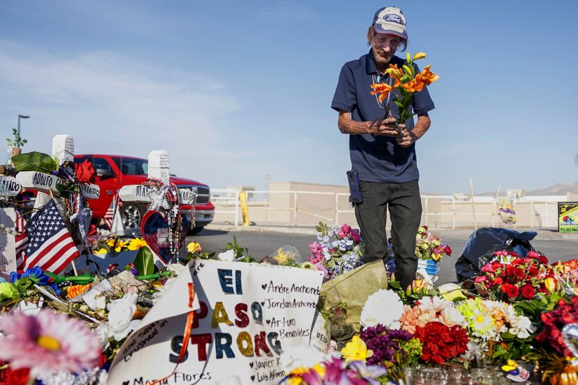 Antonio Basco, whose wife, Margie Reckard, was one of 22 killed by a gunman at a local Walmart, lays flowers in her honor at