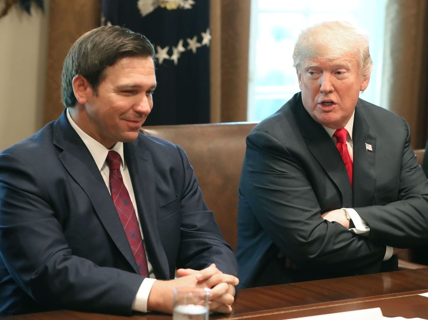 Then Florida Gov.-elect Ron DeSantis (R) sits with President Donald Trump in the Cabinet Room at the White House on Dec. 13,