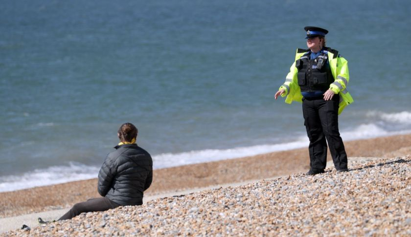 An individual is questioned on Brighton seafront