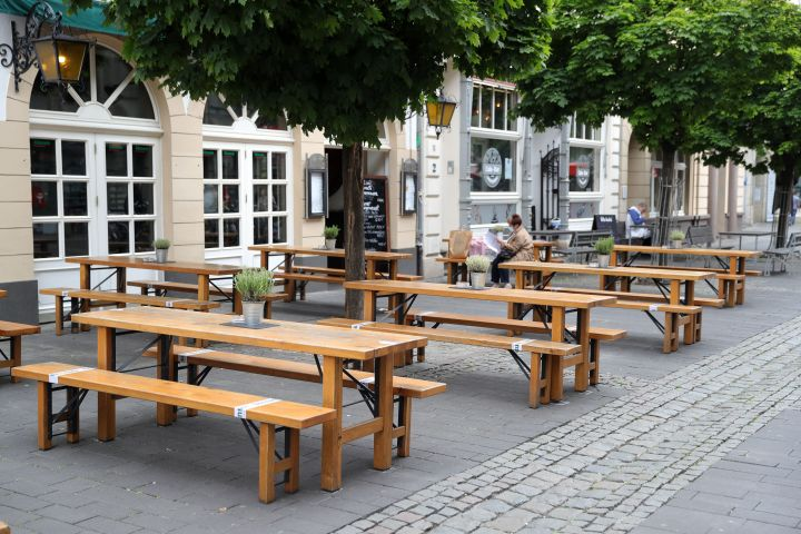 A customer sits outdoors a day after restaurants and cafes were allowed to reopen for the first time since March in Cologne, Germany.