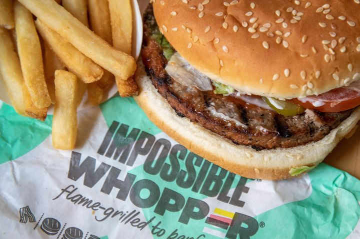 """Burger King's Impossible Whopper contains <a href=""""https://www.fatsecret.com/calories-nutrition/burger-king/impossible-whopper"""" target=""""_blank"""" rel=""""noopener noreferrer"""">25 grams of protein</a>."""