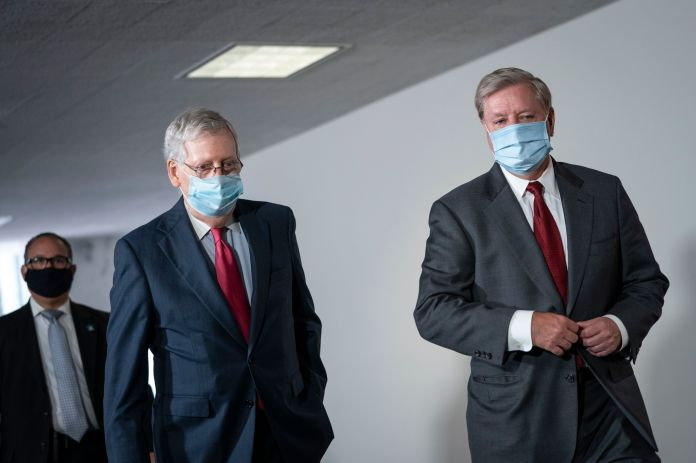 The majority leader in the Senate, Mitch McConnell (R-Ky.) And Senator Lindsey Graham (R-S.C.) Arrive for a meeting ...