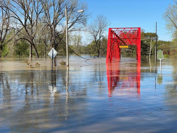 Floodwaters overwhelm a bridge two blocks from the home of Armin Mersmann, a Midland-based artist.