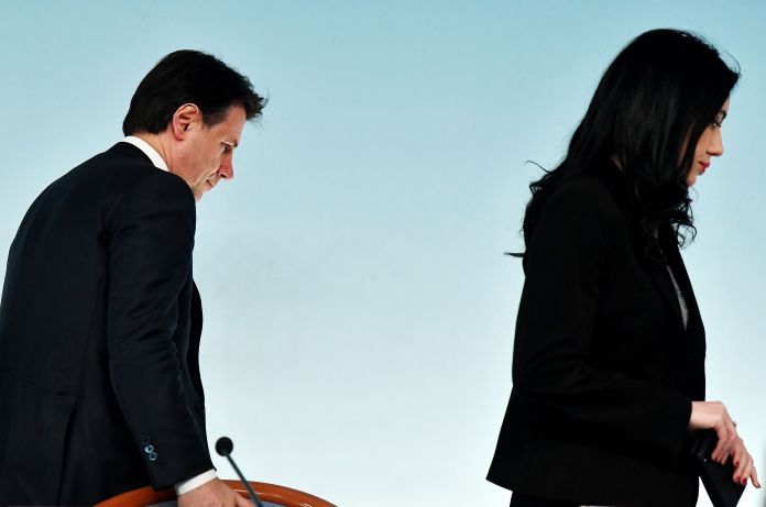 Italy's Prime Minister Giuseppe Conte (L) and Italy's Public Education Minister Lucia Azzolina leave ...