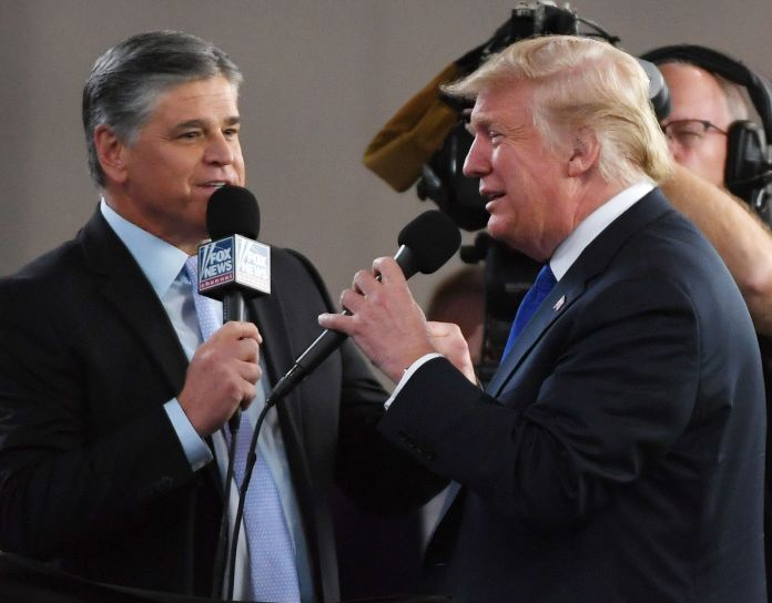Fox News Channel and radio talk show host Sean Hannity interviews Trump before a campaign rally in 2018. Hannity has sycophan