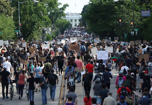Hundreds of demonstrators march toward Lafayette Park and the White House to protest against police brutality and the death o