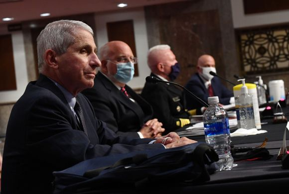 From left, Dr. Anthony Fauci, director of the National Institute for Allergy and Infectious Diseases, and others testify befo