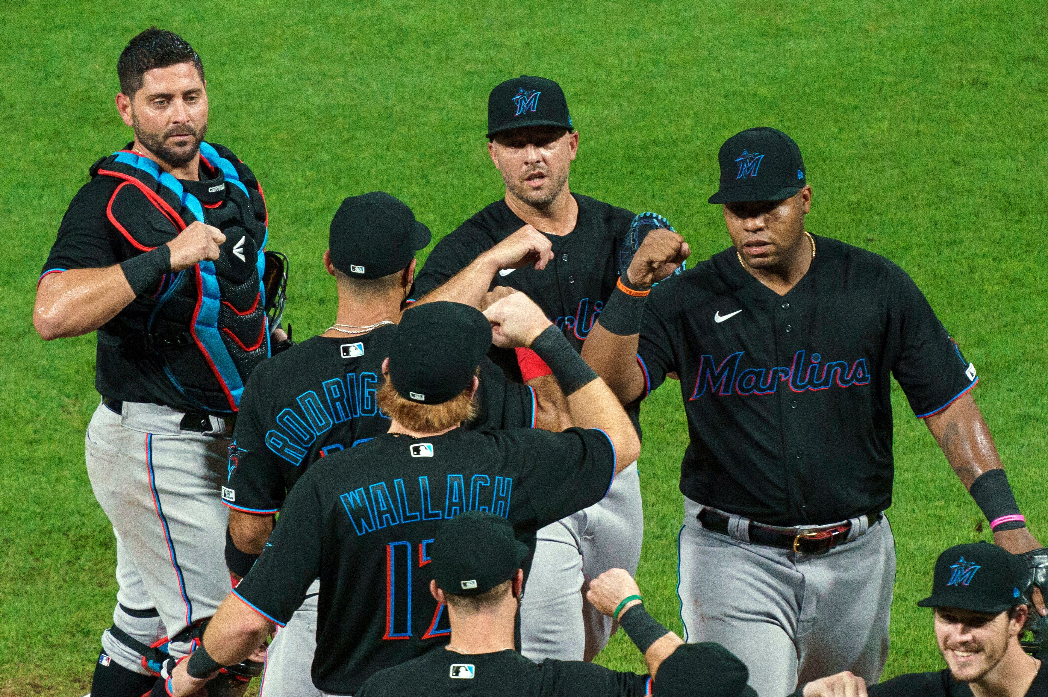 FILE - In this Friday, July 24, 2020, file photo, Miami Marlins' Jesus Aguilar, right, celebrates a 5-2 win with teammates fo