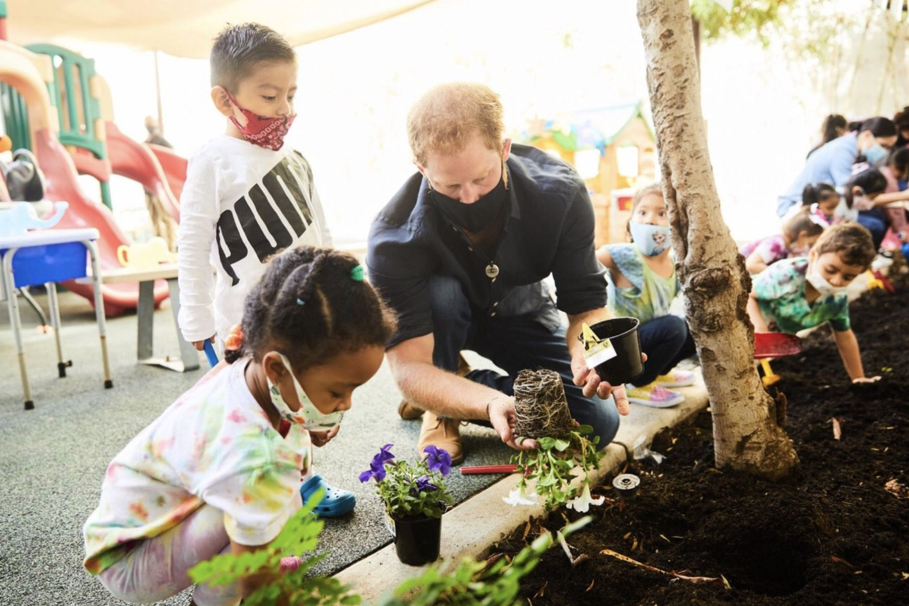 """In addition to gardening, the Duke and Duchess of Sussex read aloud a few books, including """"Jack and the Beanstalk."""""""