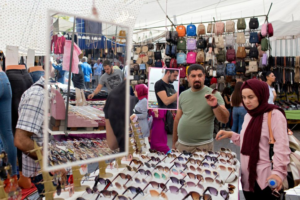 Vendors switch from selling sunglasses to face masks at a stall in the Fatih Market in Istanbul, where wearing a mask in public is mandatory. Markets are an essential part of life in Istanbul, and every neighborhood has its own. Any given market is usually cramped, but since the pandemic, markets are empty compared to what they once were. Above: July 31, 2019| Below: July 29, 2020