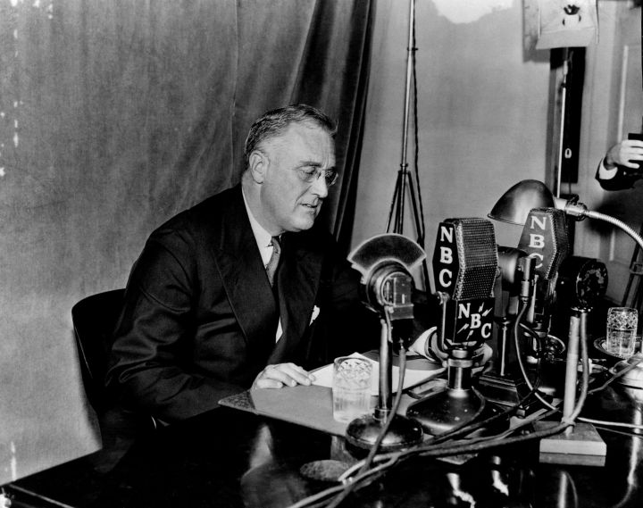 """President Franklin Roosevelt delivers one of his """"fireside chats"""" broadcast on NBC Radio."""