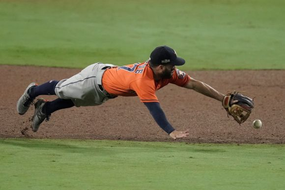 Houston Astros second baseman Jose Altuve misses a single by Tampa Bay Rays' Ji-Man Choi during the sixth inning in Game 7 of
