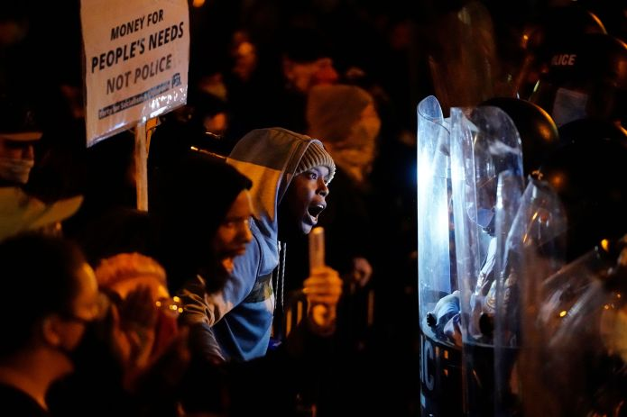 Protesters confront police during a march, Tuesday, Oct. 27, 2020, in Philadelphia. Hundreds of demonstrators marched in West