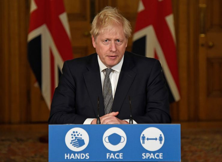 British Prime Minister Boris Johnson speaks during a press conference on Saturday, during which he announced new restrictions