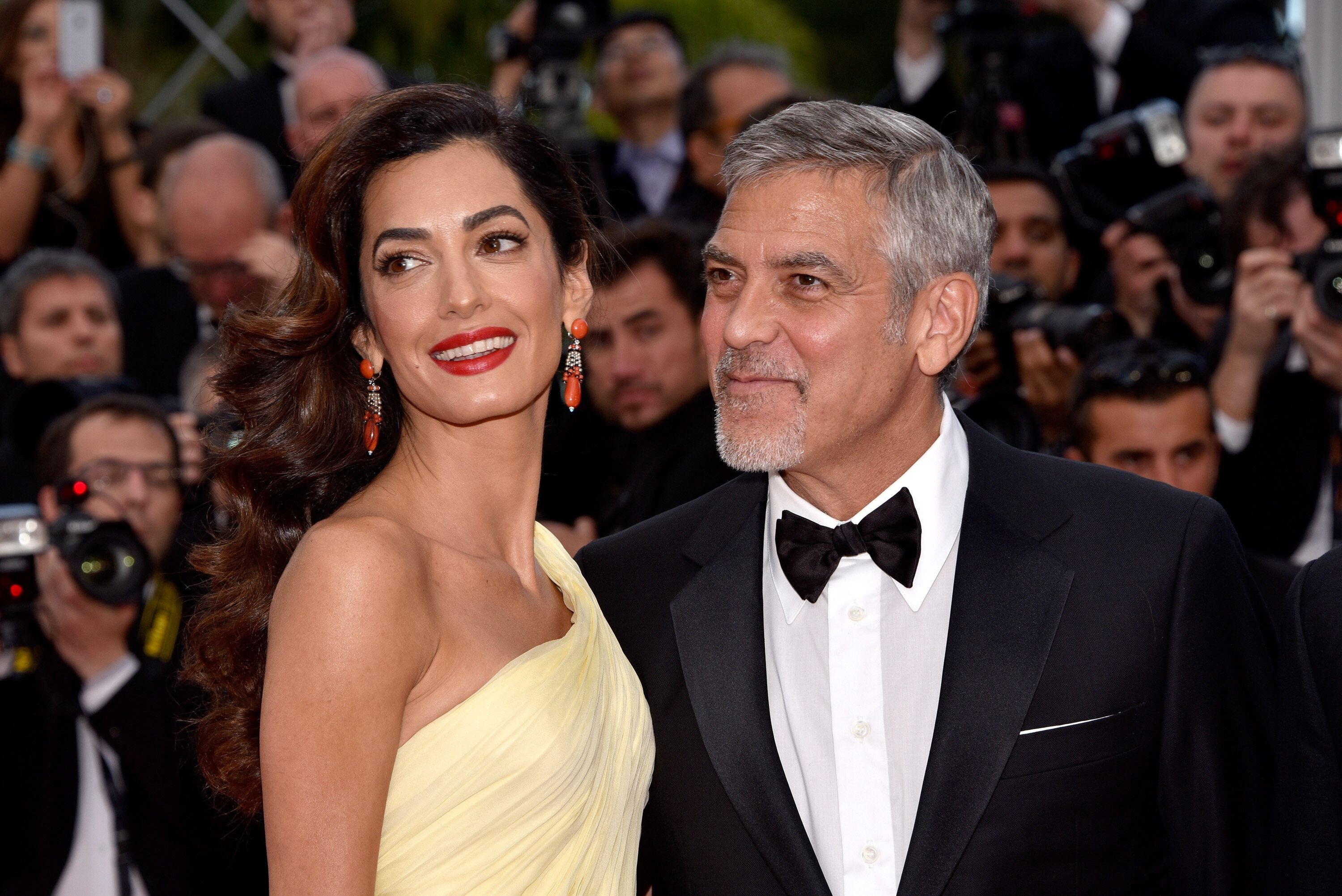 """George and Amal Clooney attend the """"Money Monster"""" premiere during the 69th annual Cannes Film Festival on May 12, 2016.&nbsp"""