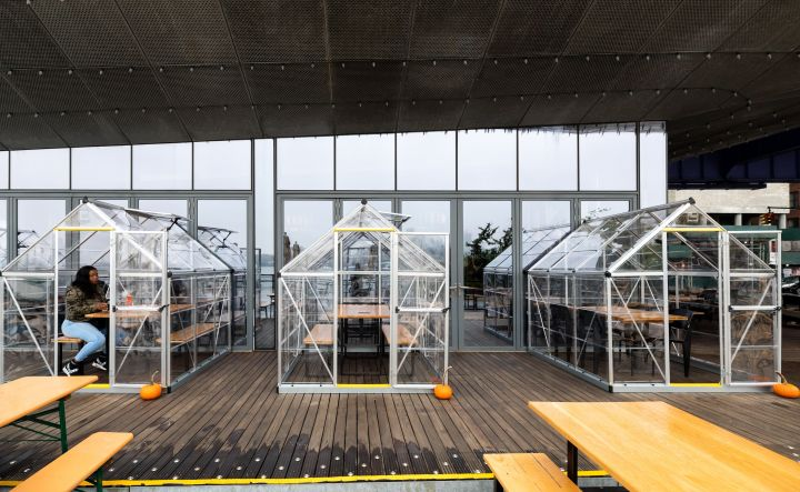 """A diner eats in a plastic """"house"""" tent at Industry Kitchen in Lower Manhattan on Oct. 26."""