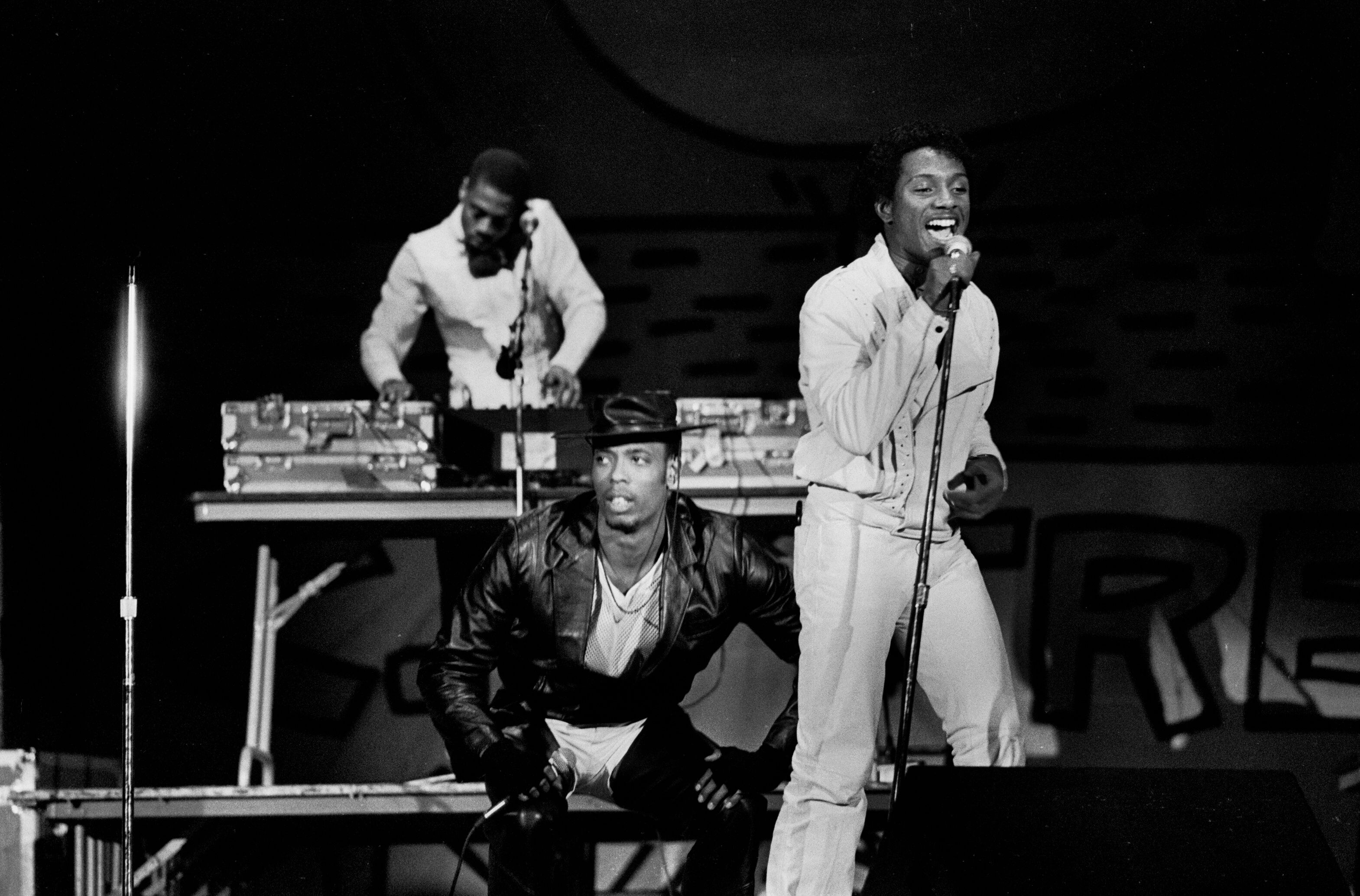 """John """"Ecstacy"""" Fletcher, center in the hat, performs with Whodini during a 1984 concert in Chicago."""