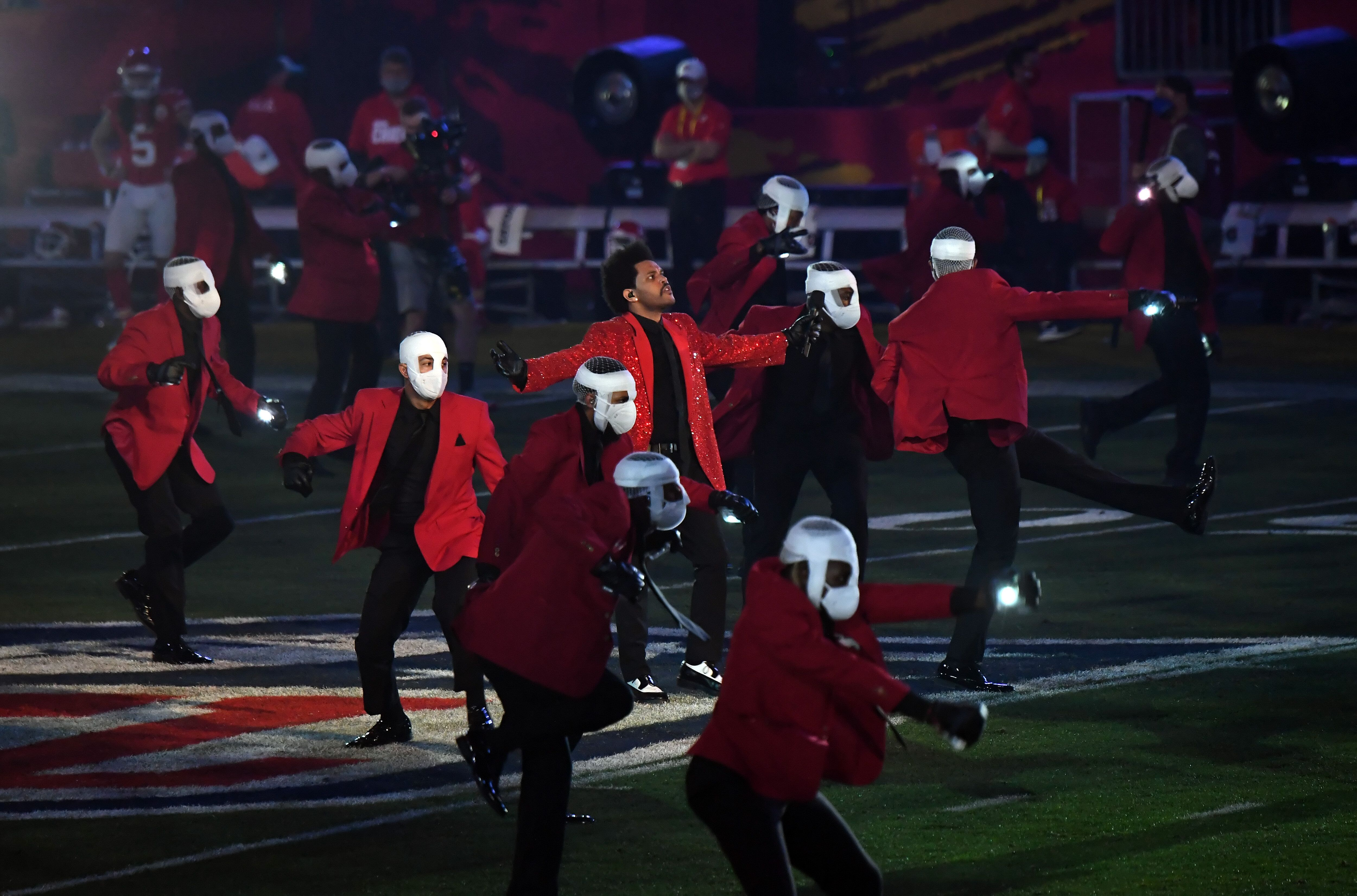 The Weeknd performs among dancers during the 2021 Super Bowl halftime show in Tampa, Florida.