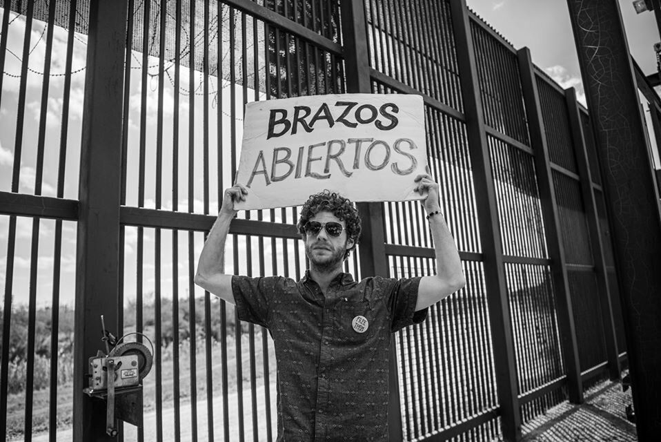 The author stands at the border during his time in Brownsville, Texas.