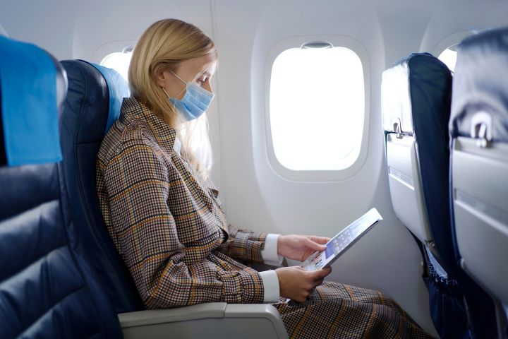 Even after getting the COVID-19 vaccine, you should wear a protective mask if you have to fly.