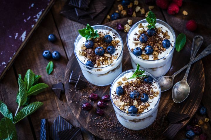 Greek yogurt topped with fruits and nuts is a simple, high-protein breakfast.