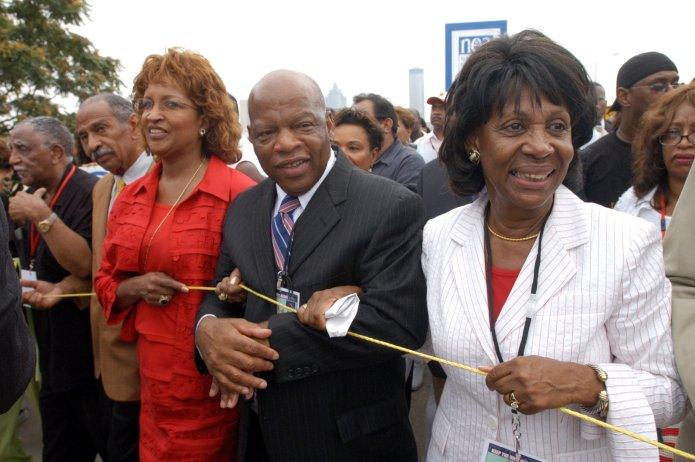 AME Bishop Vashti McKenzie, Rep. John Lewis (D-Ga.) and Rep. Maxine Waters (D-Calif.) head down Atlanta's Martin Luther King