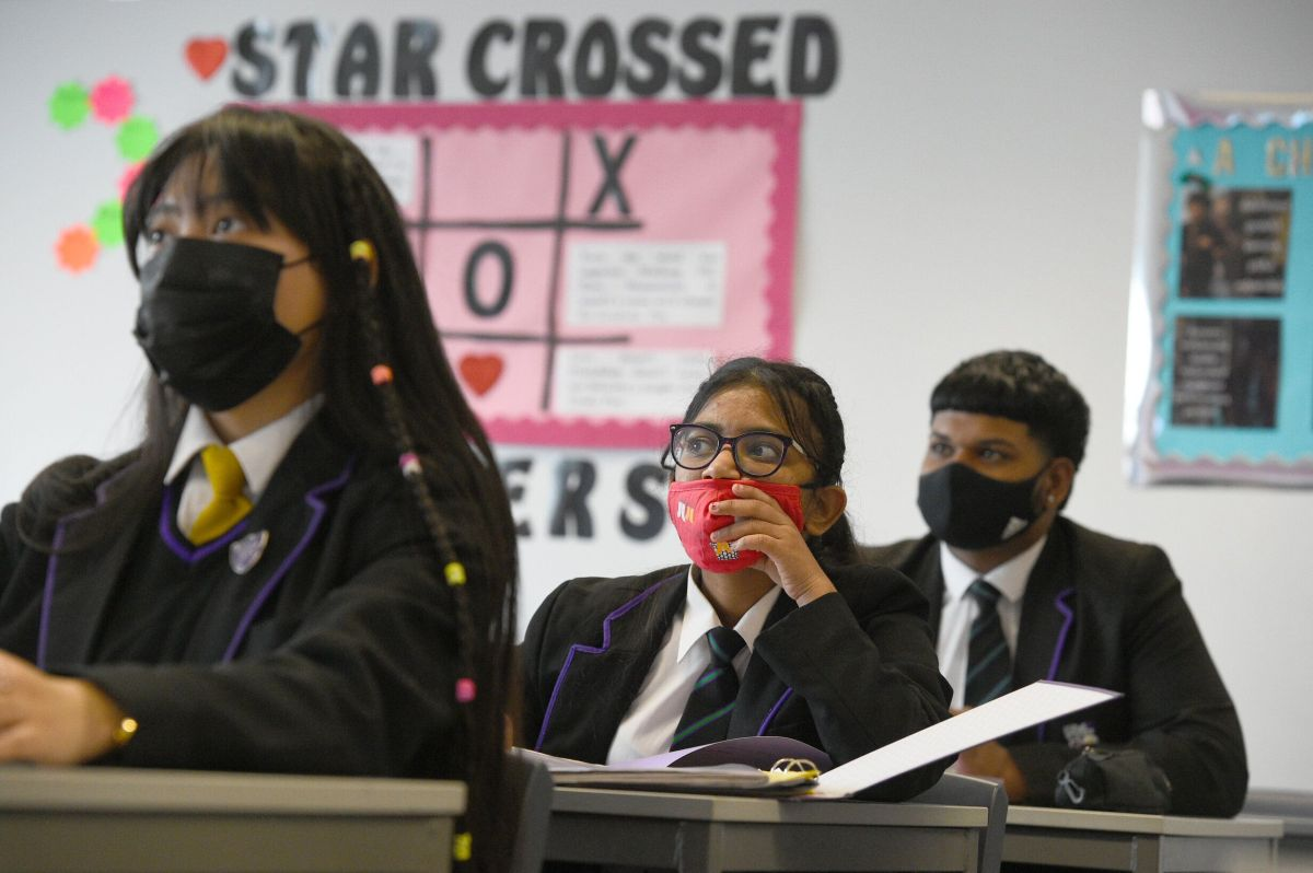 Children wearing facemasks in their Tutor Form Group listening to a virtual assembly at Hounslow Kingsley...