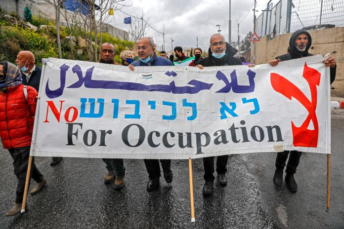 Palestinian, Israeli and foreign activists protest against Israeli occupation and settlement activities in the Palestinian Te