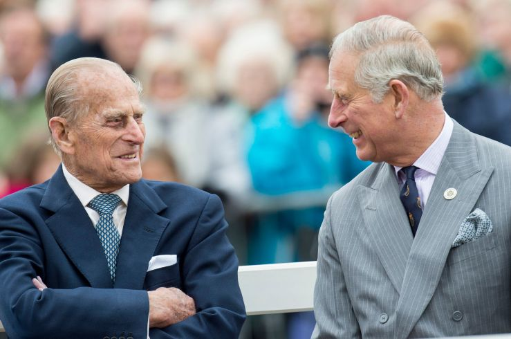 Prince Philip and Prince Charles attend the unveiling of a statue of the Queen Mother during a visit to Poundbury on October