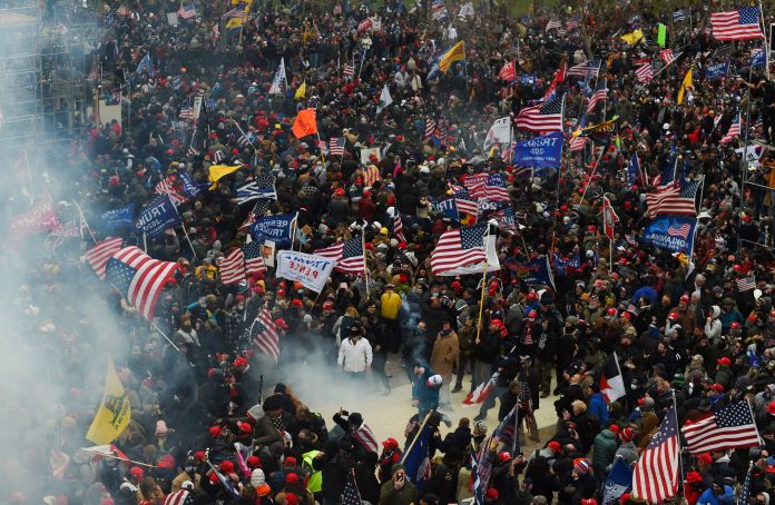 Trump supporters clash with police and security forces as they storm the U.S. Capitol on Jan. 6. Demonstrators entered the Ca